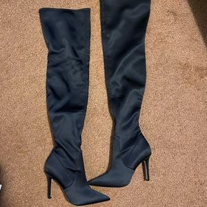 Over the knee high black satin boots